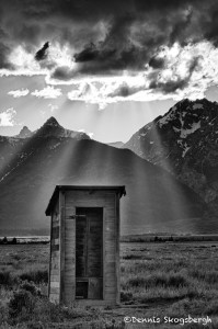 1301 Crepuscular rays ('God beams') on outhouse, Grand Teton National Park,WY